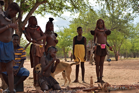 KAMANJAB, NAMIBIA - FEB 1, 2016: Unidentified Himba people shown in himba tribe village