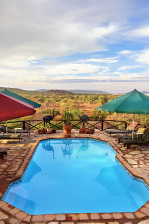 unspoilt: DAMARALAND, NAMIBIA - FEB 04, 2016: Swimming pool in Toko Lodge. Toko is the gateway to Western Etosha, Damaraland and the unspoilt Kaokoveld