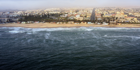 Aerial view on the coast in Namibia and historical districts of the city Swakopmund. City placed between the Namib desert and Atlantic ocean, Africa Stock Photo