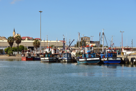luderitz: LUDERITZ, NAMIBIA - JAN 26, 2016: The port of Luderitz, Luderitz is a harbour town in southwest Namibia, lying on one of the least hospitable coasts in Africa Editorial