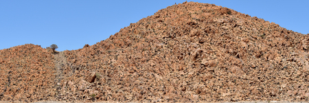large formation: Beautiful landscape with a dike is a large slab of rock formation in the Namib desert, Namibia, Africa Stock Photo