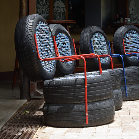 OMBIKA, NAMIBIA - FEB 03, 2016: Chairs made from used car tires. An example of a non-standard design from recycled materials Imagens - 60518667