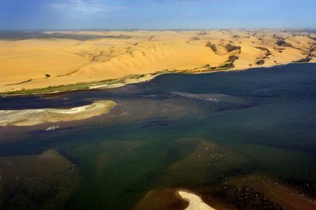 sandbank: Aerial view on the sandbank in the Atlantic ocean near a coast in Namibia where dunes of the Namib desert meet with Atlantic ocean, Africa