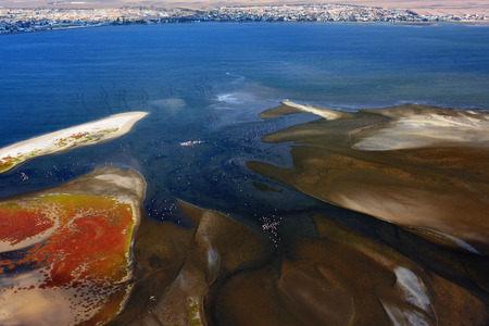 sandbank: Aerial view on the sandbank in the Atlantic ocean near a coast in Namibia and the city Walvis Bay on background, Africa