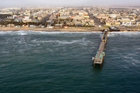 swakopmund: Aerial view on the coast in Namibia and historical districrts of the city Swakopmund in the Namib desert, Atlantic ocean, Africa