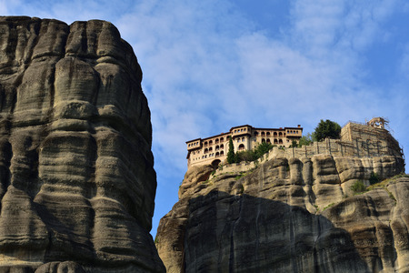kalambaka: Meteora monasteries, bottom view on the Holy Monastery of Varlaam on the rock at sunset time, Greece