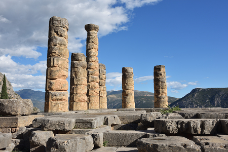oracle: Apollo Temple in Delphi, an archaeological site in Greece, at the Mount Parnassus. Delphi is famous by the oracle at the sanctuary dedicated to Apollo. Stock Photo