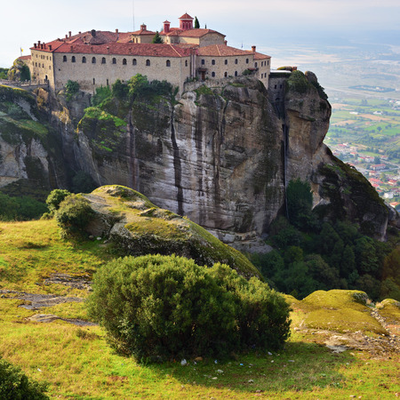 seclusion: Meteora monasteries. Beautiful view on the Holy Monastery of Saint Stephen placed on the edge of high rock at sun rises, Kastraki, Greece