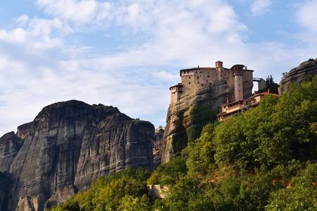 inaccessible: View on the beautiful Holy Monastery Roussanov at sunset time, Meteora, Greece Stock Photo
