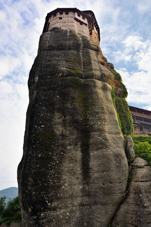 inaccessible: View from bottom on the Monastery Roussanov at sunrise, Meteora , Greece Stock Photo