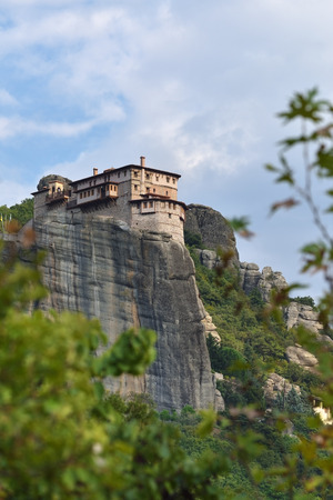 View from bottom on the Holy Monastery Roussanov at sunset time, Meteora, Greece