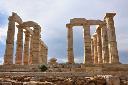 gods: Greece. Attica. Cape Sounion - Ruins of an ancient Greek temple of Poseidon before sunset under dramatic cloudy sky