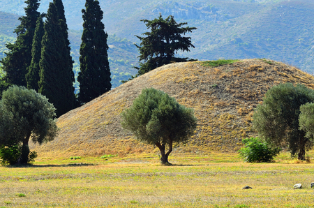 tumulus: The tumulus or burial mound of the 192 Athenian  fallen at the Battle of Marathon also called the Soros, which was erected near the battlefield Stock Photo