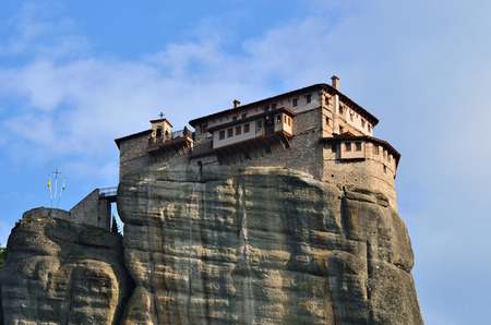 inaccessible: View from bottom on the Holy Monastery Roussanov at sunset time, Meteora, Greece