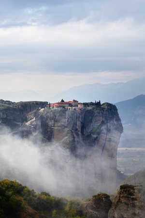 kalambaka: Meteora monasteries. Beautiful view on Monastery of the Holy Trinity placed on the edge of high rock covered of the morning at sun rises, Kastraki, Greece