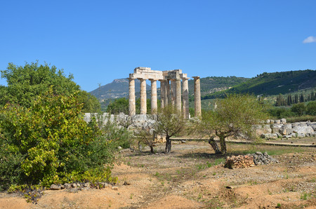 classical greek: Classical greek landscape, olive trees, mountain and ruins of the temple of Zeus near ancient Nemea, Peloponnese, Greece
