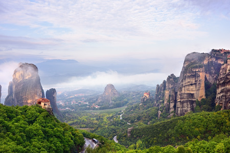 Meteora monasteries. Beautiful landscape and view on the Holy Monastery of Roussanov placed on the edge of high rock before sunset. Kastraki, Greece Stock Photo