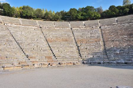 teatro antiguo: Greece. Ancient Theatre in Epidaurus (also Epidauros, Epidavros) built in 340 BC. This beautiful and best preserved theatre is on UNESCO World Heritage List since 1988. Small depth of field