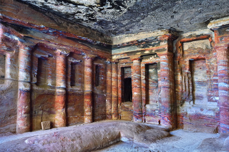 Petra, the Colored Triclinium ( 200 BC) decorated with engaged columns and niches, and was originally covered with painted stucco. The stucco was fallen away to reveal the natural colors