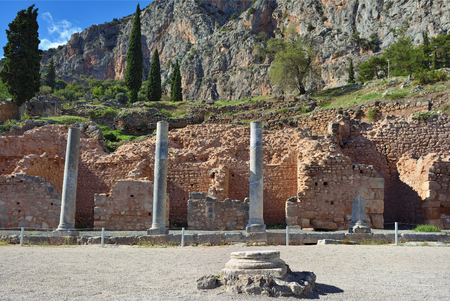 delphi: Ancient columns in Ancient Greek archaeological site of Delphi shown at warm evening light, Central Greece Stock Photo