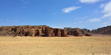 timna: Solomons Pillars panorama, Timna park, Israel. The pillars were formed over 500 million years ago by rain penetrated into fissures in the sandstone
