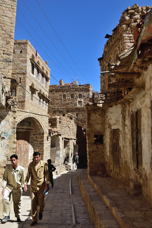 mideast: Thula, Yemen - MAR 14, 2010: People on the street in medieval of Thula. Thula is a UNESCO World Heritage City now destroyed by the civil war