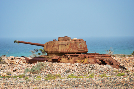 Rusty soviet battle tank T-34 on the shore of the Indian Ocean at the Socotra Island, Yemen