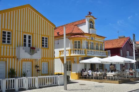 Costa Nova, Portugal – June 09, 2017: Famous resort on the Atlantic coast in Beira Litoral, Portugal. Popular tourist destination to spend vacation time
