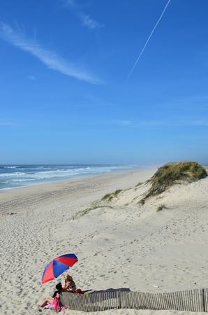 Costa Nova, Portugal - June 09, 2017: Atlantic Ocean, Costa Nova beach in Aveiro. People relaxe on the  very popular place to spend weekends and vacation time Editorial
