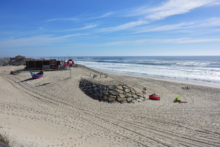 Costa Nova, Portugal - June 09, 2017: Atlantic Ocean, Costa Nova beach in Aveiro, very popular place to spend weekends and vacation time