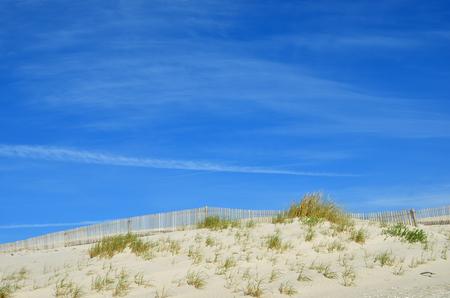 Sand dunes at Costa Nova, a famous beach near Aveiro, Centro, Portugal Фото со стока