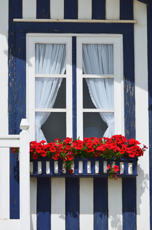 Detail of the house in famous resort Costa Nova on the Atlantic coast in Beira Litoral, Portugal. Popular tourist destination to spend vacation time