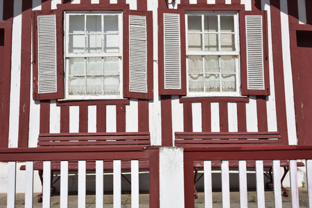 Detail of the house in famous resort Costa Nova on the Atlantic coast in Beira Litoral, Portugal. Popular tourist destination to spend vacation time Imagens - 80755964