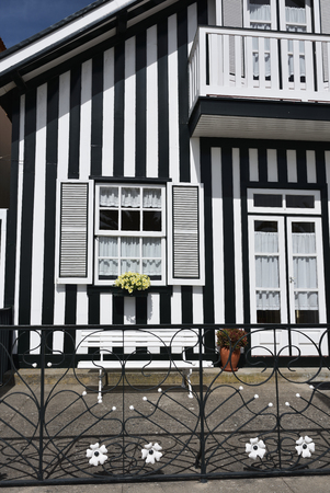 to spend: Detail of the house in famous resort Costa Nova on the Atlantic coast in Beira Litoral, Portugal. Popular tourist destination to spend vacation time