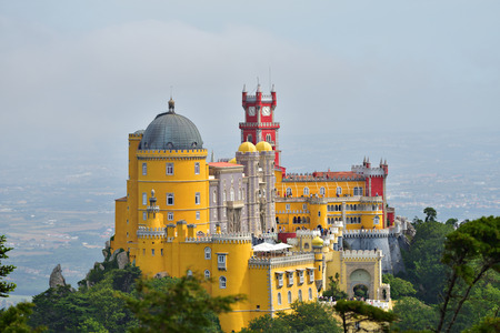 Panoramic view of Pena National Palace in Sintra in a beautiful summer mist sunrise, Portugal Editorial