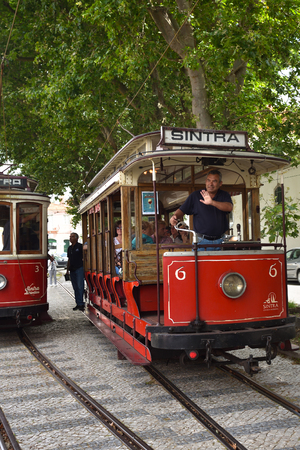 tramway: SINTRA, PORTUGAL - June 12, 2017: Vintage red trams shown on the streets of Sintra. Old trams are one from a lot of tourist attraction in Sintra Editorial
