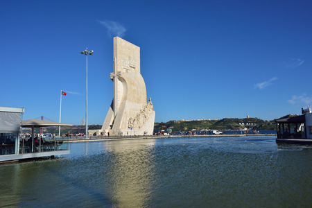 tagus: LISBON, PORTUGAL - JUNE 11, 2017: Monument to the Discoveries (Padrao dos Descobrimentos) at the Tagus river with view on 25th of April Bridge