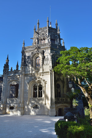 Palace Quinta da Regaleira, Sintra Portugal. Palace with symbols related to alchemy Masonry the Knights Templar and the Rosicrucians shown at sunset. Masterpiece of Neo-Manueline architecture style