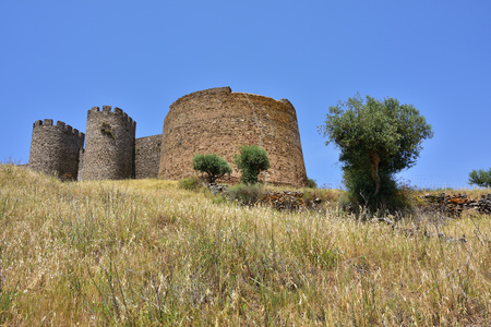 Beautiful view of the Castle of Evoramonte with its circular towers. Initiated around 1306 it was enlarged in the later centuries in the Manueline style.