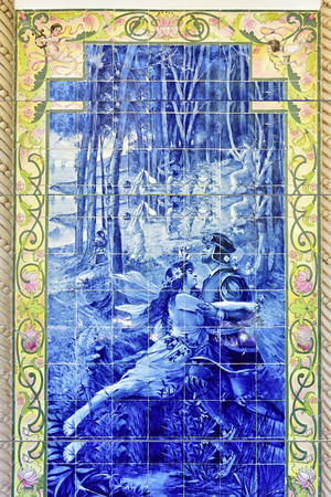 Luso, Portugal - June 10, 2017: Blue azulejo panel of tiles showing love scene in the forest.