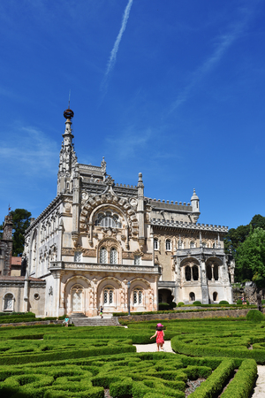 Luso, Portugal - June 10, 2017: Medieval Bussaco Palace and its garden near Luso in Portugal. Palace built in 1628 as a convent