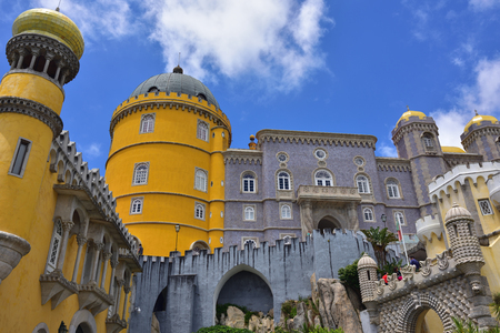 plastered wall: Sintra, Portugal - June 06, 2017: Tourists visit the Pena National Palace. The most popular tourist attraction in whole Portugal