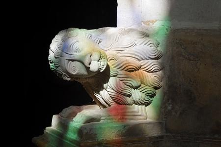 Lion head. Detail of the carved stone. The Batalha Santa Maria da Vitoria Dominican abbey, Portugal. Batalha Monastery is UNESCO World Heritage Site