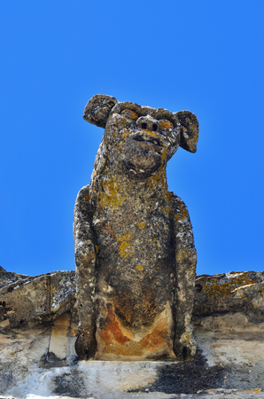 Gargoyle as the carved stone decoration of the roof of Templar church of the Convent of the Order of Christ in Tomar Portugal Stock Photo