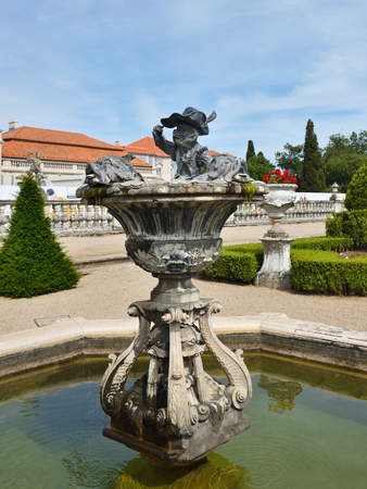 Queluz, Portugal - June 3, 2017: Neptune gardens, fountain baroque in the Queluz Royal Palace. Formerly used as the Summer residence by the Portuguese royal family Editorial
