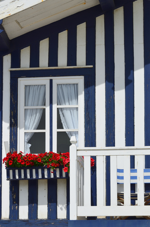Detail of the house in famous resort Costa Nova on the Atlantic coast in Beira Litoral, Portugal. Popular tourist destination to spend vacation time Imagens - 83377950