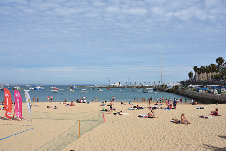 retrieved: Cascais, Portugal - June 8, 2017: People sunbathing on the Praia Ribeira public beach. Cascais is famous and popular summer vacation spot for Portuguese and foreign tourists Editorial