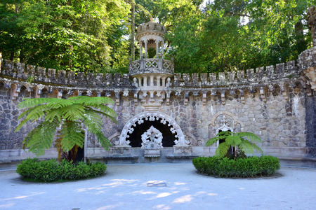 Ancient fountain in neo-Gothic style in a public park in Sintra, Portugal