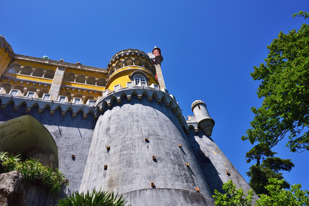 plastered wall: Sintra, Portugal - June 06, 2017: View from bottom on the Pena National Palace. The most popular tourist attraction in whole Portugal