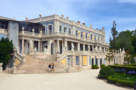 Queluz, Portugal - June 3, 2017: Tourists on the Lion staircase or Robillon at Queluz National Palace. Formerly used as the Summer residence by the Portuguese royal family